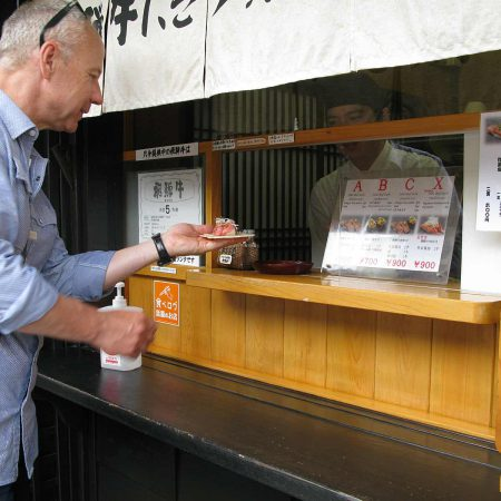 Win at a snack bar buying a Hida Beef snack