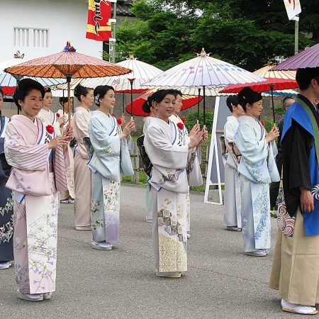 Women dressed in komono at a parade in Kanazawa