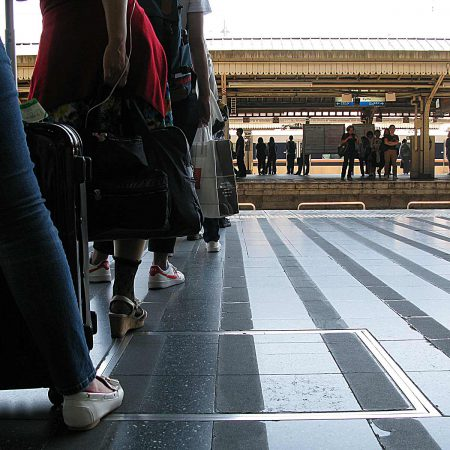 People at the train station properly lined up
