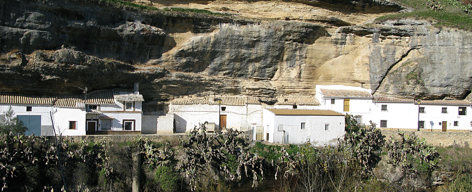Houses in Setenil de las Bodegas, Andalusia, being built into the rock walls of the gorge of Rio Trejo