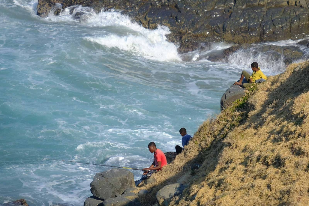 Fishermen sitting at a steep slope at the Wild Coast